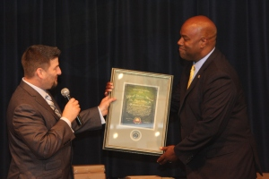 Ambassador Clyde Rivers receives the Life of Honor Award from the iChange Nations Elite Global Network.